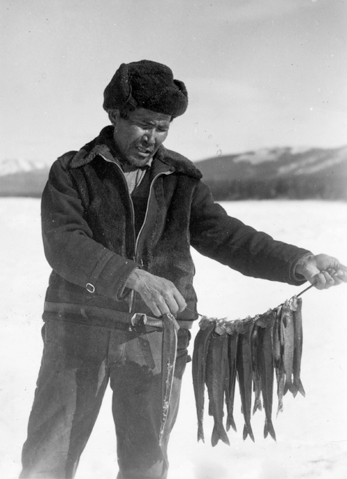 Simon McLeod holding a stringer of grayling, 1938.