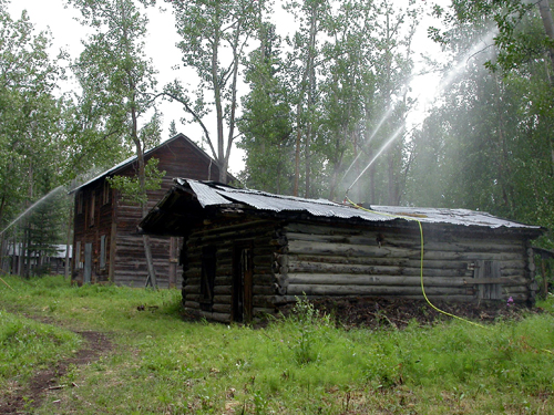 Conservation staff set up sprinklers when forest fires threatened the townsite in 2006.