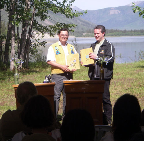 Tr'ondëk Hwëch'in Chief Darren Taylor and Yukon Government Minister Brad Cathers at the signing ceremony formalizing the acceptance of the Management Plan for the Forty Mile, Fort Cudahy and Fort Constantine Historic Site, June 2006.