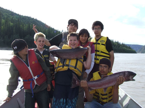 At First Fish Camps, youth learn about safe boating, modern and traditional salmon harvesting practices and the principles of stewardship. L-R, front row: Jared, Chase Everitt, Daniel Carr; middle row: T.J. Gaudet, Jen Meirau; back row:  Derek Scheffen and Nick Close.