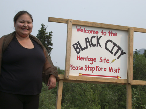 Patricia Lindgren and other Tr'ondëk Hwëch'in citizens celebrated the 25th anniversary of the completion of the Dempster Highway by welcoming visitors to the Black City site, 2002.