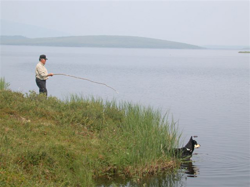 Robert Alexie fishing on the shores of Chapman Lake.