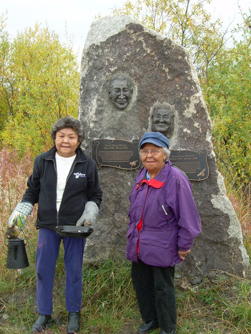 This memorial to Joe and Annie Henry at near km 102 of the Dempster Highway was commissioned by their granddaughter, artist Jackie Olson. Annie's daughters, Eileen Olson and Marcel Marcellin, Sept. 2007.