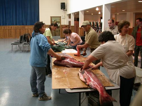 Preparing salmon for a community feast.