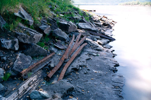 Erosion of the riverbank has left these rails from the Klondike Mines Railway lying on the beach.