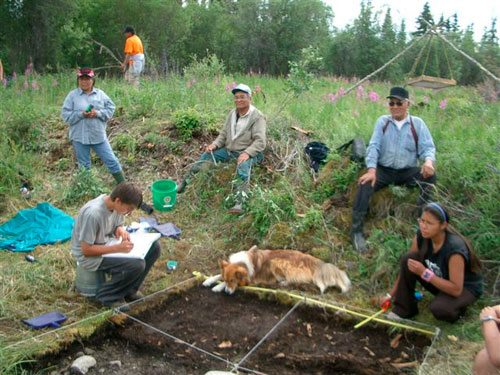 Steve Kocsis, Gladys Alexie, Corey Alexie, Walter Alexie, Robert Alexie and Charmaine Christiansen near a house pit at Black City, 2004.