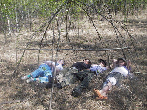 Robert Service School students take a break after building willow frames of traditional shelters, 2008.