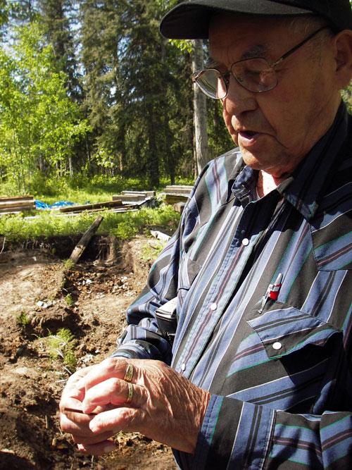 Elder J.J. Van Bibber examining an artifact at Forty Mile.