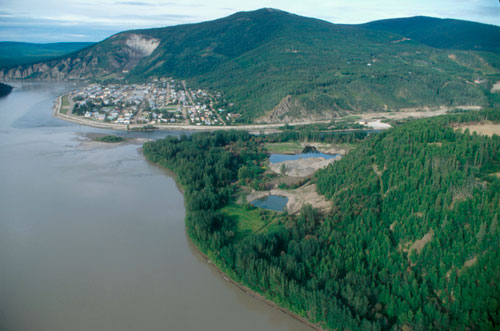 Looking north down the Yukon River towards Dawson City. Tr'ochëk is in foreground. The two ponds were created during placer mining in 1991.