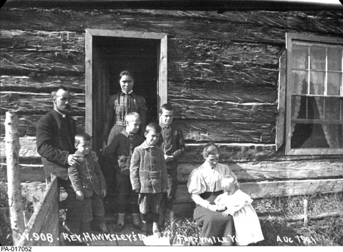 Reverend John Hawksley, his family and an unidentified First Nations woman at Buxton Island, August 1901. In 1914, Hawksley became the Yukon's first Indian Agent.