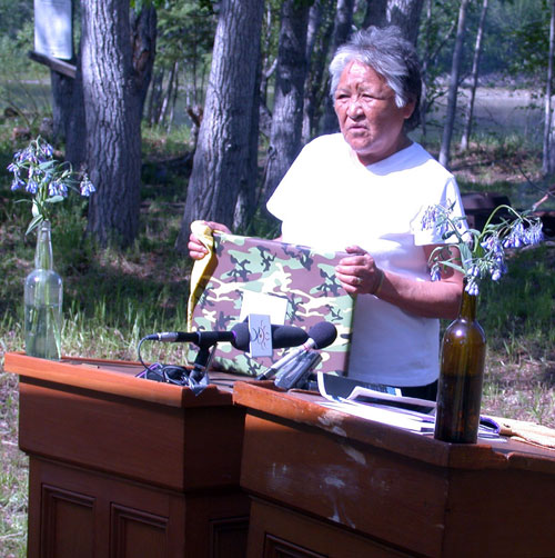 Elder Peggy Kormendy, a member of the Steering Committee that guided the planning for the Forty Mile site, speaks at the official signing ceremony in June 2006.