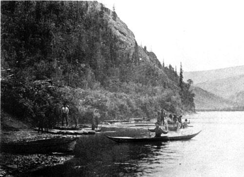 Fishing at Tr'ochëk, 1894. Notice the dipnet on the back of the birchbark canoe.