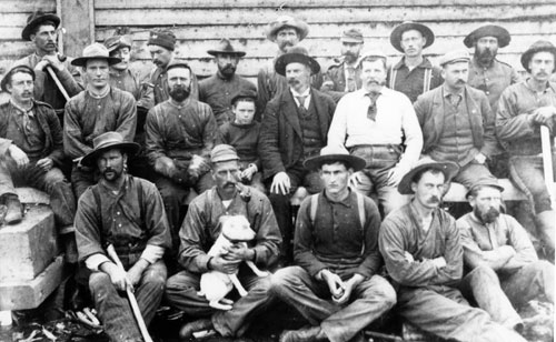 Members of the first Mounted Police detachment in the Yukon. Inspector Charles Constantine is in centre to the right of the little boy.