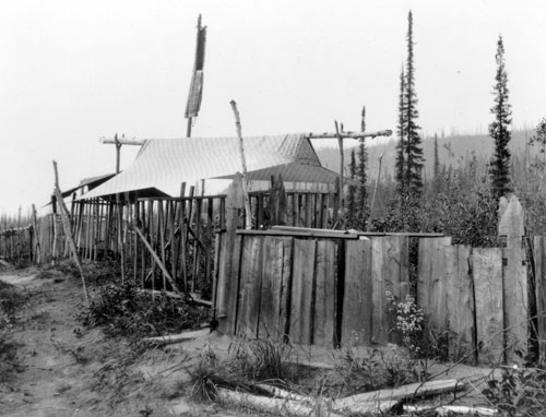 Grave fences in the Moosehide cemetery ca. 1898. Many First Nations people died during the Klondike gold rush from unfamiliar diseases carried by the newcomers.