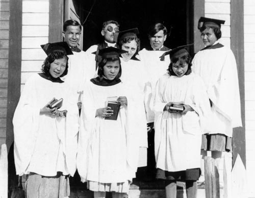 Moosehide choir, ca. 1930s. Back row, L-R: Jimmy Wood, Rev. Richard Martin, Bertha Harper (Russell), Mason McLeod, Lucy Wood. Front row, L-R: Angela Isaac (Lopaschuk), Martha Simon (Warville), Susan Simon (Joseph).