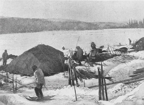 Tr'ondëk Hwëch'in winter camp, ca. 1898. The dome shelter is made of caribou hides over a pole framework. The snowshoes worn by the hunters likely have webbing made from caribou babiche or strips of rawhide.