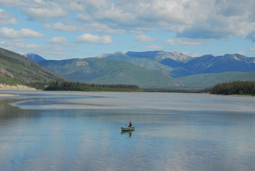 Fishing at the confluence of the Fortymile and Yukon rivers, the Cloudy Range in the distance.